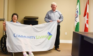 <b>Sandra Jarbo &amp; Mayor John Reinwald</b><br />Sandra Jarbo presents the Community Living Flag to Mayor John Reinwald, Town of Laurentian Hills