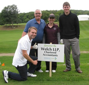 <b>Hal Ward & Team show off their Hole Sponsor Sign</b>