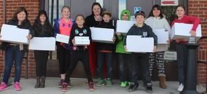 Children from Holy Name School pick up their lunches